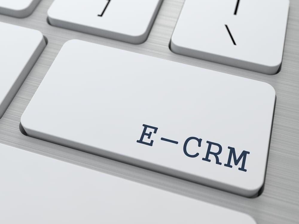 E-CRM. Information Technology Concept. Button on Modern Computer Keyboard. 3D Render.